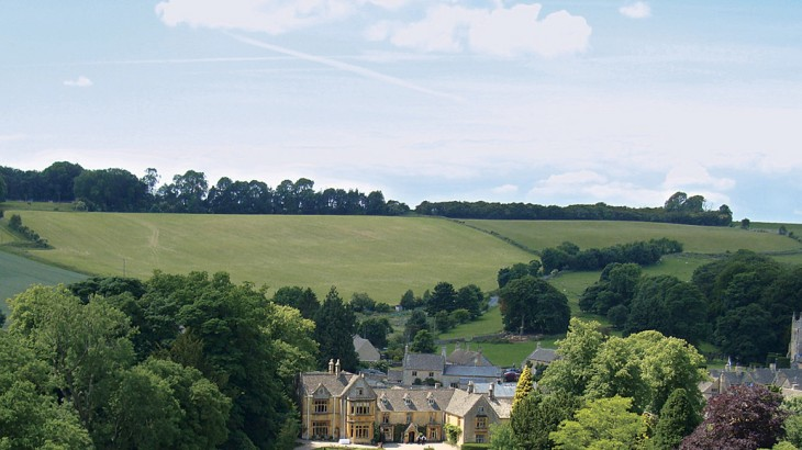 Lords of the Manor Hotel is a former 17th-century rectory built of honey-colored Cotswold stone and set amid three hectares of walled garden and parkland outside of the village of Upper Slaughter.