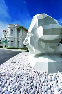 A bust of the island's former governor, Norman Macalister, stands outside the newly renovated mansion.