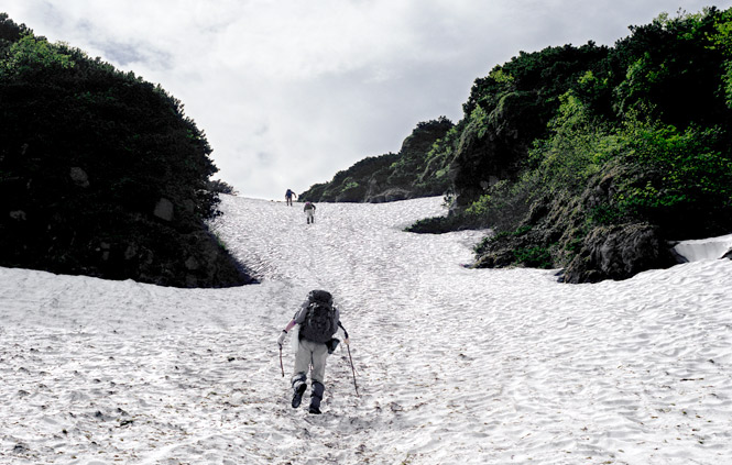 Peak Performance Climbing a snowfield on the slopes of Mount Rausu.