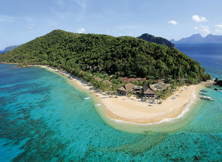 The resort is located between a lush rain forest and a fine white-sand beach.