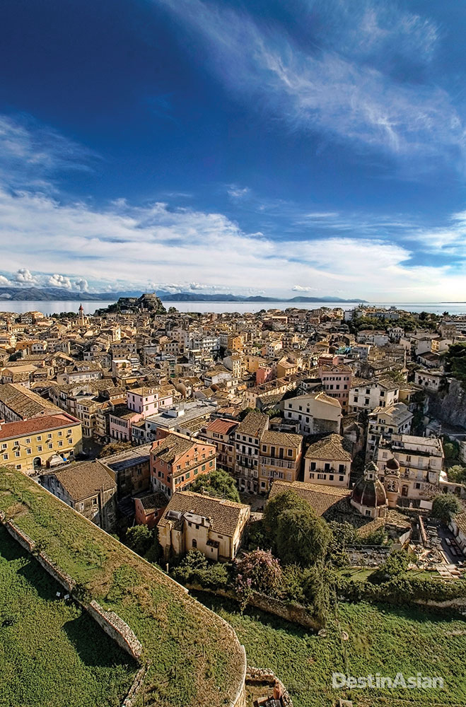 Overlooking Corfu Town, with the bulk of its Venetian-built Palaio Frourio (Old Fortress) rising in the distance.