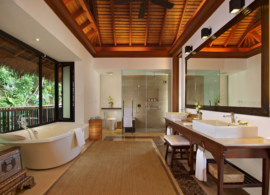 Soaks bathtubs and seagrass carpet appear in bathrooms.