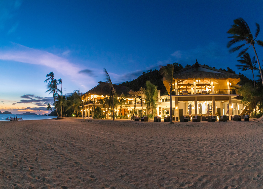 The island's resort center by night.