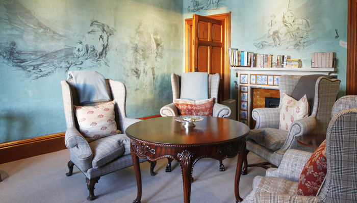 Another living room in the lodge with painted walls.