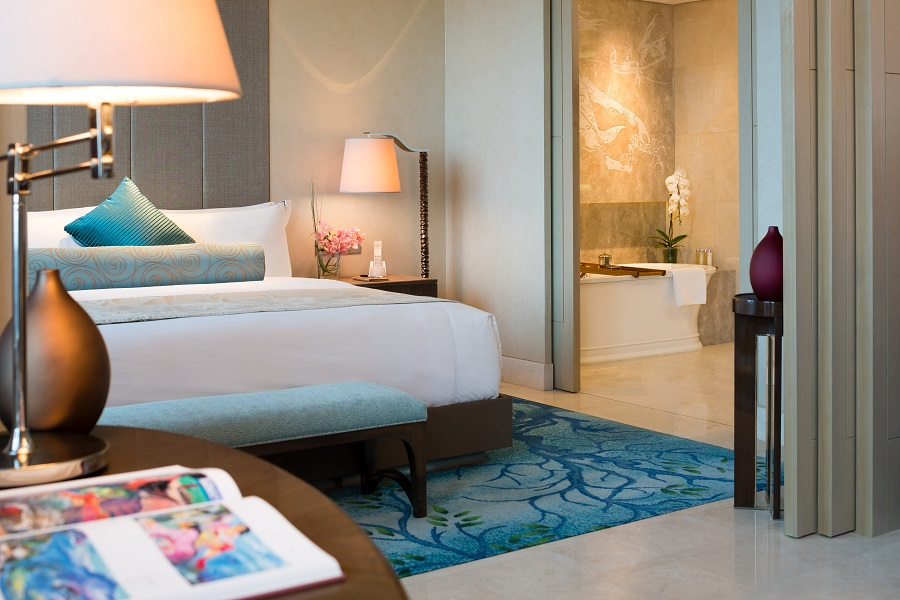 Guest rooms at Raffles feature floor-to-ceiling windows and butler service.