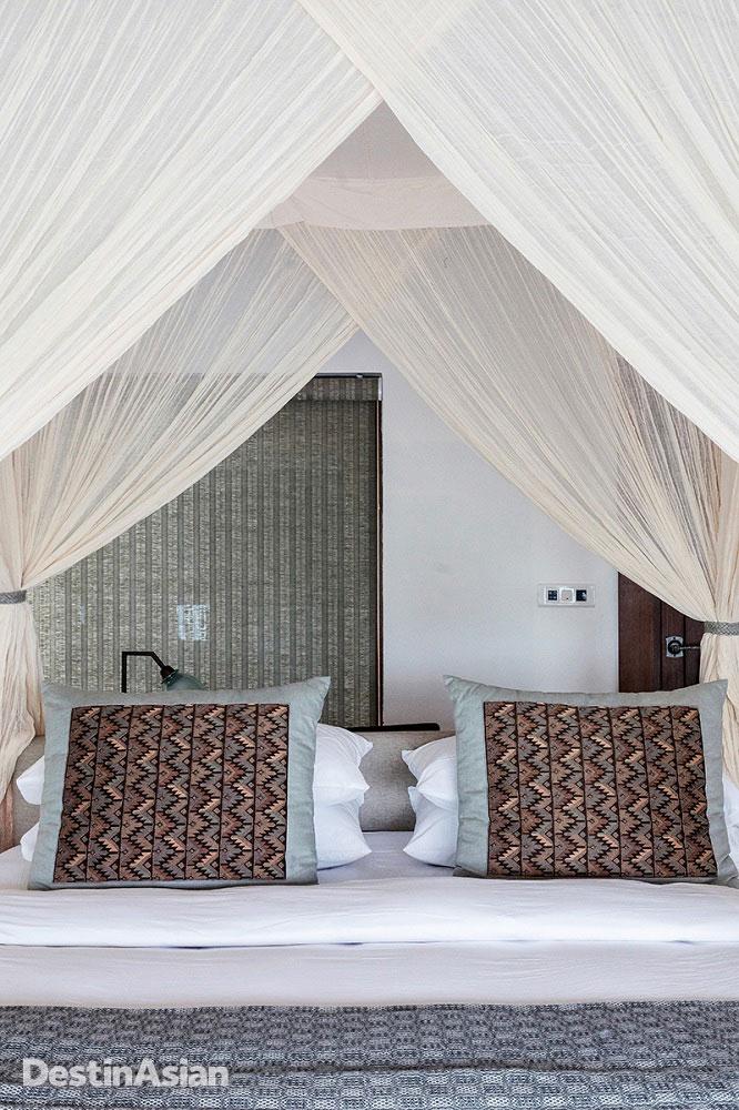 A villa bedroom at Meghauli Serai.