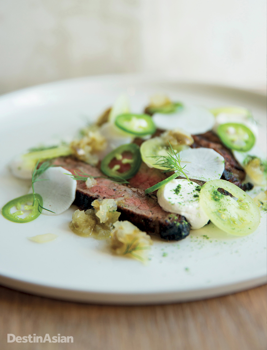 Smoked flank steak with pickled jalapenos, tomatillo, and sour cream at Petition Kitchen.