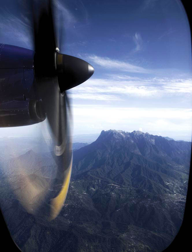 A bird's-eye view of Sabah's lofty Mount Kinabalu, en route to Sandakan from the state capital of Kota Kinabalu.