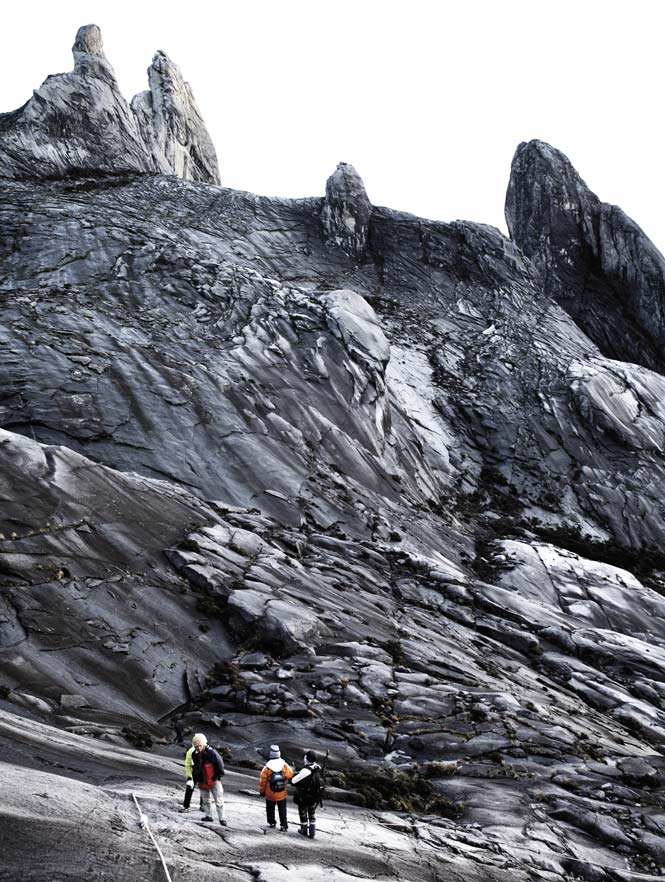 Hikers on the approach to Low's Peak, the 4,095-meter summit of Mount Kinabalu.