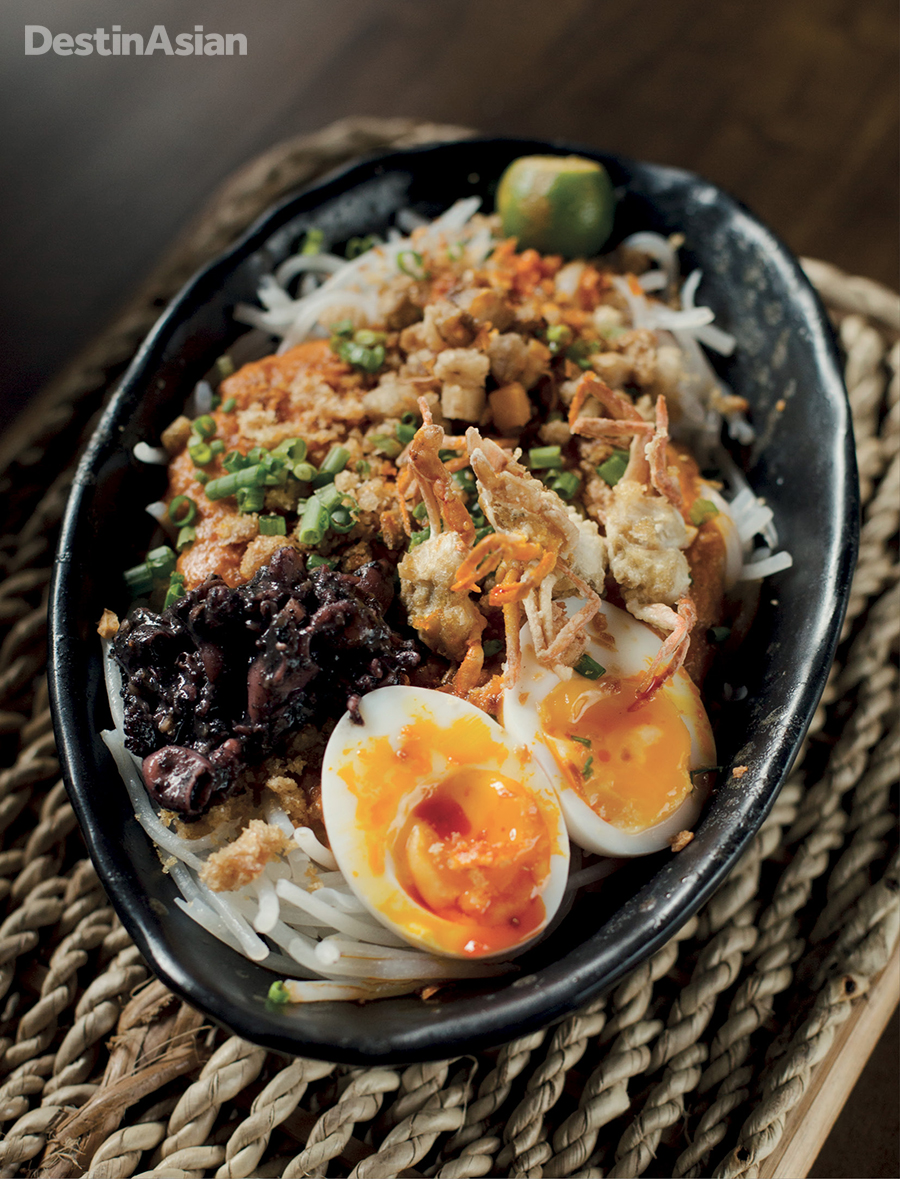 Pancit palabok - a quintessential Philippine noodle and seafood dish - at Kafe Batwan.