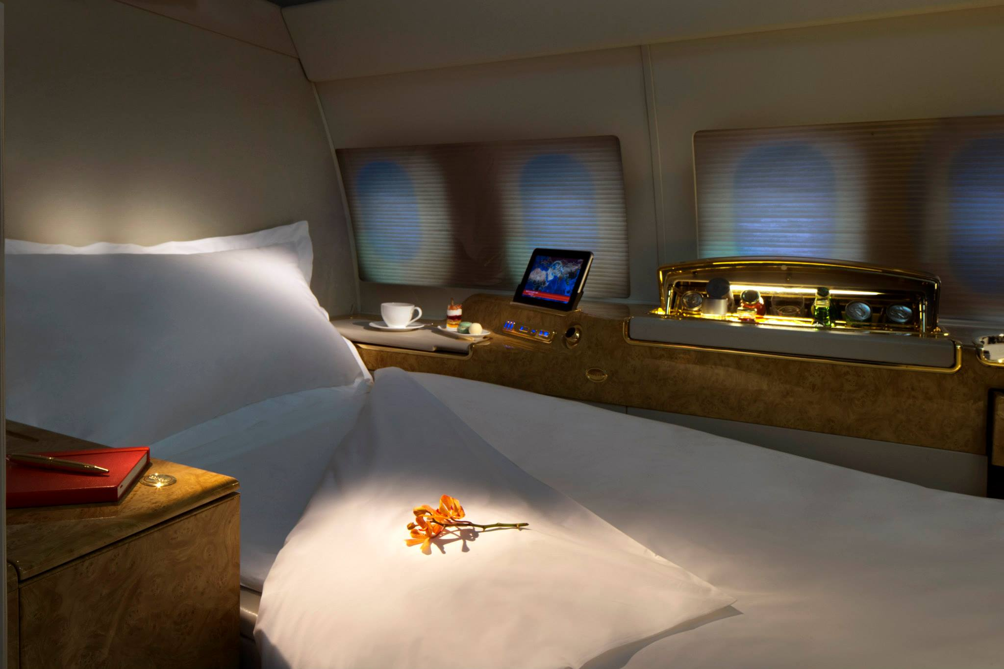 10 private suite aboard the plane feature fully-flat seat beds and personal entertainment systems.