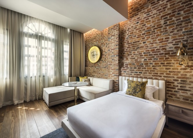 The shophouses' orignal brick walls and wood floors are complimented with local artwork and colorful throw pillows.