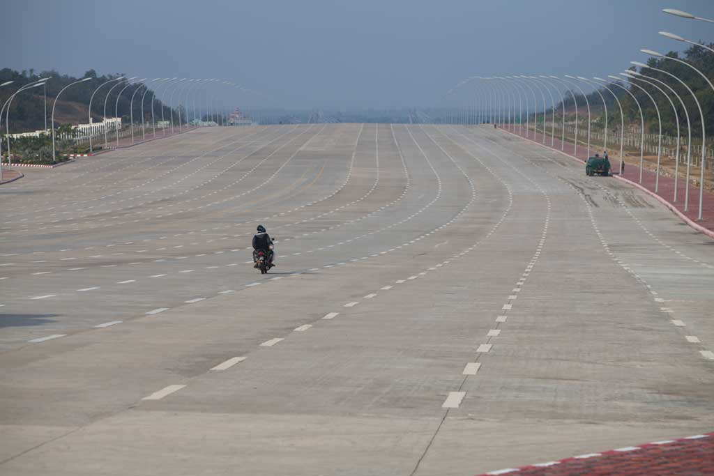 A sole motorbike travels along the 20-lane road that leads to the country's parliament complex in Naypyidaw.
