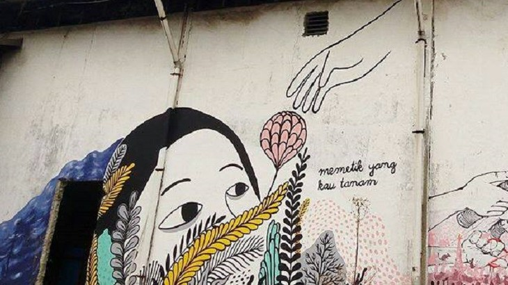 "A mural with a writing translated as ""reaping what you sow"" on Gedung Sarinah building, where the exhibition is being held."