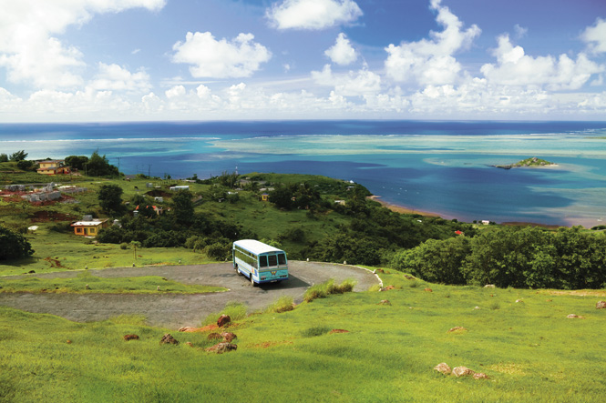 A public bus on the road to Anse Mourouk, one of the vividly colored bays that scallop Rodrigues's south coast.