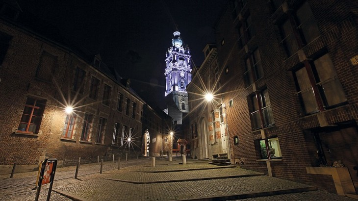 The Belfry in Mons, built in the 17th century, alight at night.