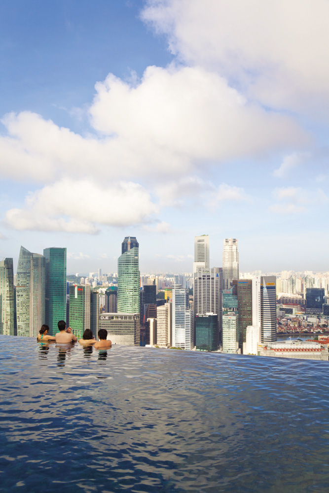 Singapore— readers' favorite city destination —as seen from the rooftop pool at Marina Bay Sands