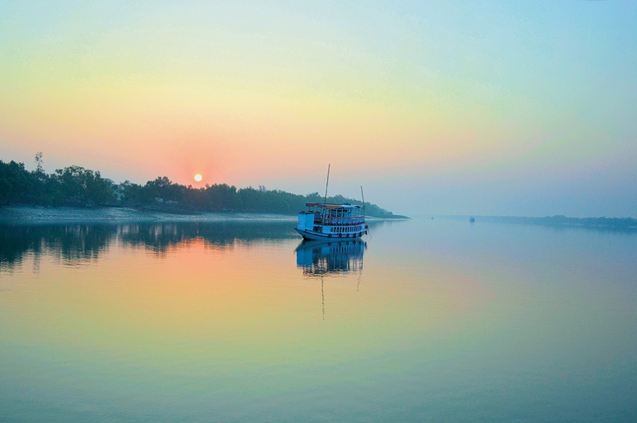 The only way to explore the protected islands and mudflats of the world's largest mangrove forest is by boat.
