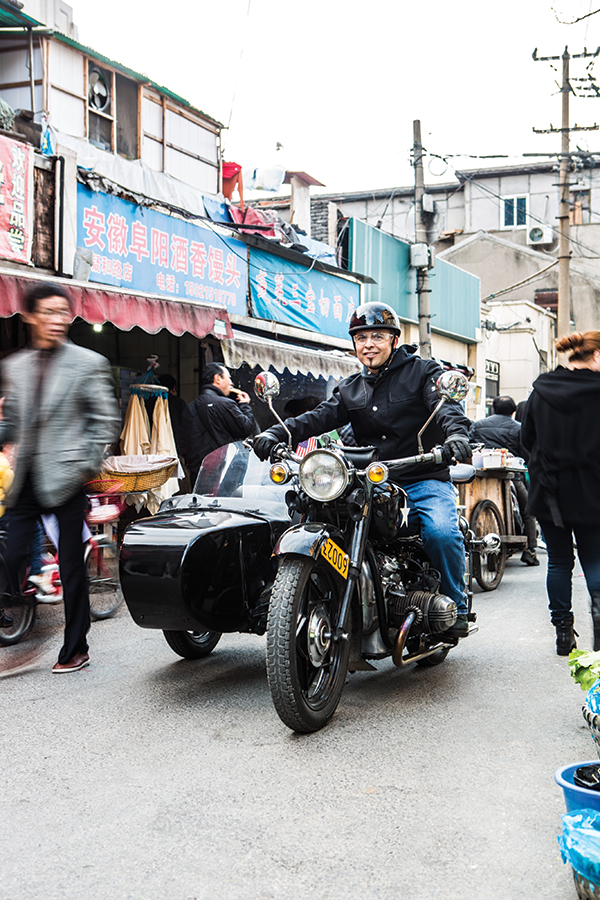 Shanghai Insiders tour rider Sammy Florez on one of the company's Chang-Jiang sidecars.