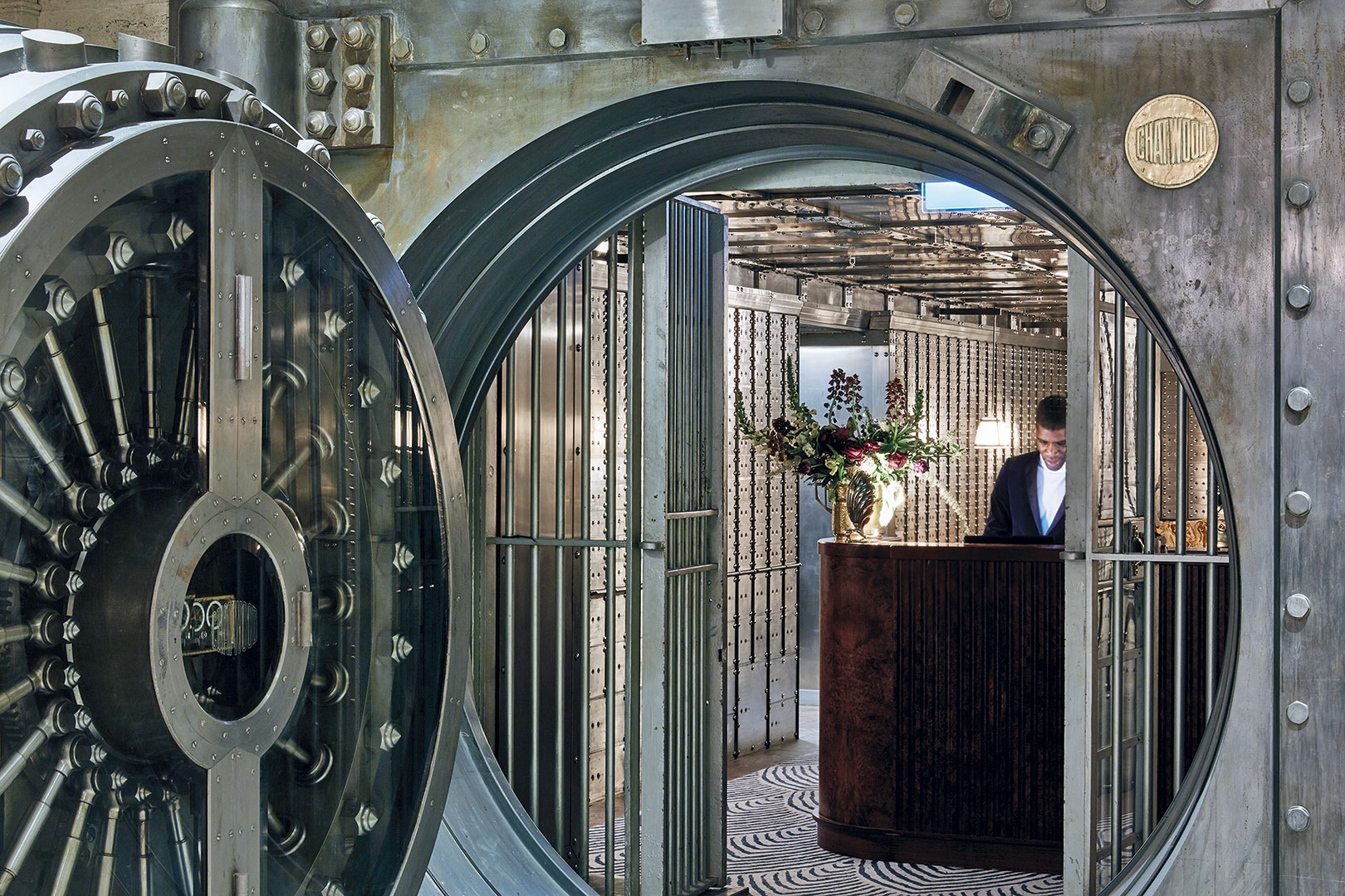 The hotel's subterranean bar and an actual former bank vault where a fortune of gold bullion was once stored.