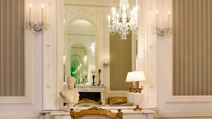 Chandelier hangs over a fireplace in the Paderewski Suite.