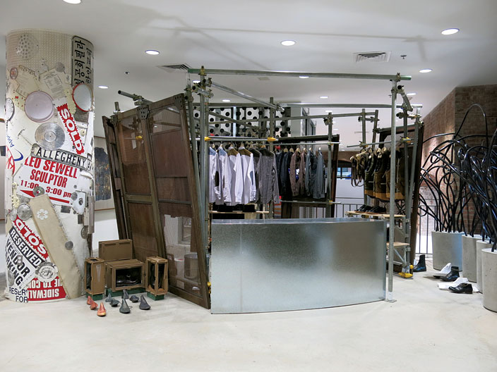 Junya Wantanabe's collection next to artwork by Leo Sewell at Dover Street Market.