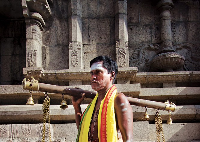 A Tamil Priest with Kavadi