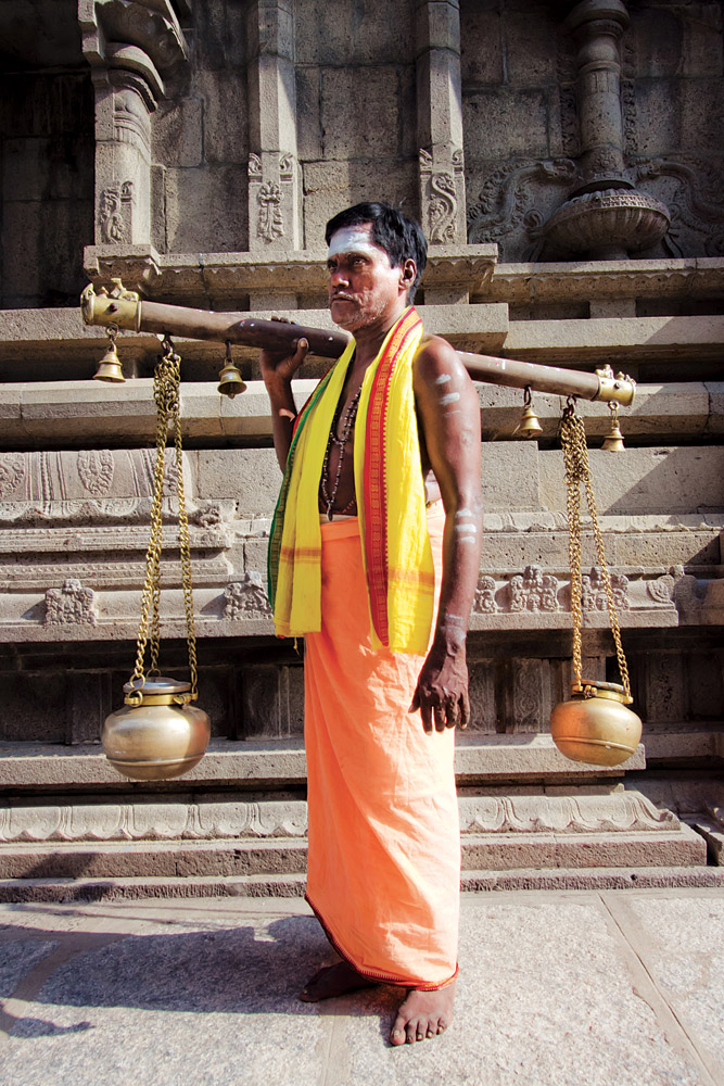 A Tamil priest with kavadi, or a ritual burden.