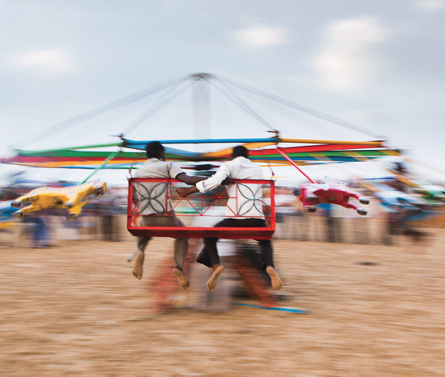 Having fun on the hand-driven carousel on Chennai's 13-kilometer-long Marina Beach, said to be the longest-and more crowed-stretch of sand in the country.