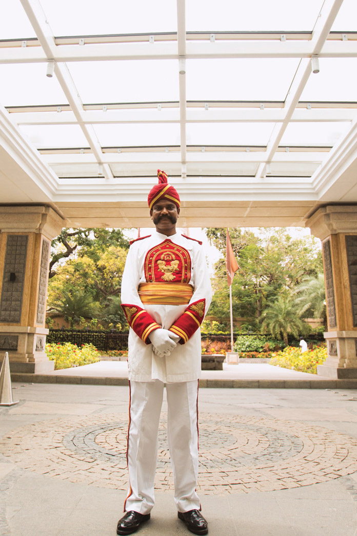 A doorman at the ITC Grand Chola.