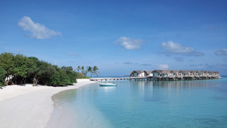 The resort's 55 overwater villas and suites are connected by a jetty to the northern end of the island, with golf buggies on hand to shuttle guests to and fro.