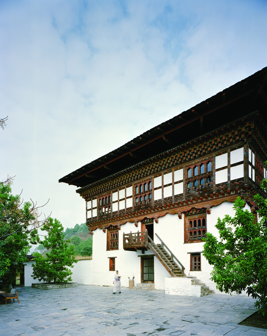 An old farmhouse serves as the focal point of Amankora Punakha, with a dining room, library, and areas for meditation.