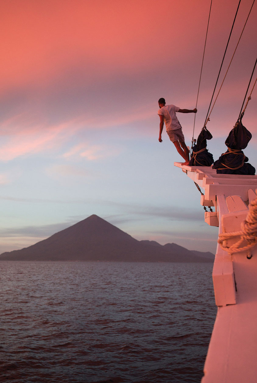 Taking a dive from the masthead of Ombak Putih.