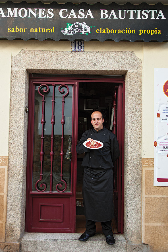 Master jamón carver Juan Jose Sanchez Trejo with paper-thin slices of Iberian ham outside Casa Bautista in Montánchez.