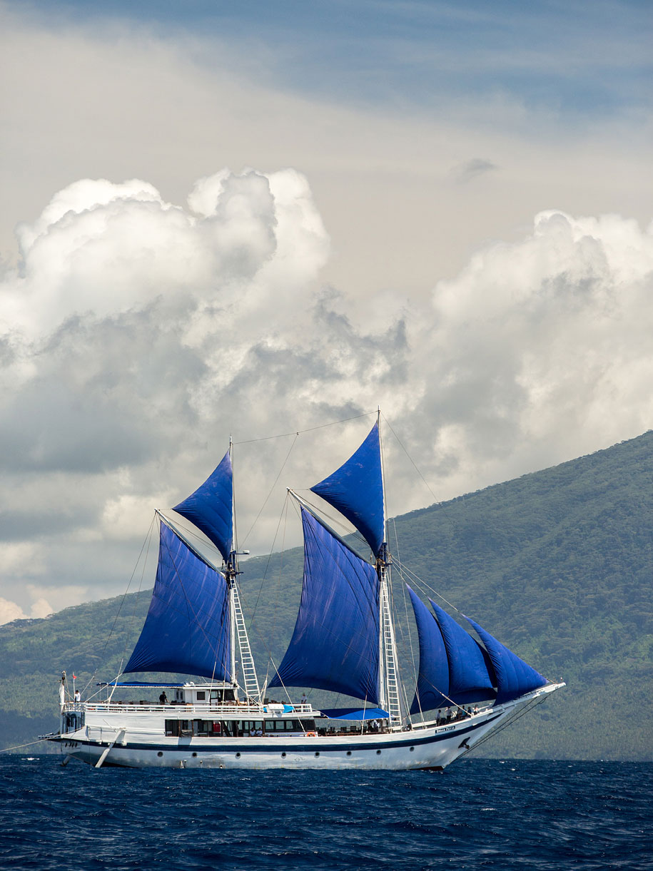 Built in the manner of a traditional Phinsi schooner, the Ombak Putih makes a fetching sight as itsails under full canvas off the volcanic island of Tidore.