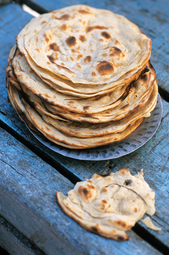 Naan bread features among the street fare sampled with Food Tours of Mumbai.