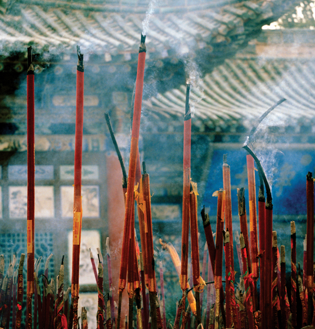 Incense sticks burning at a local temple.