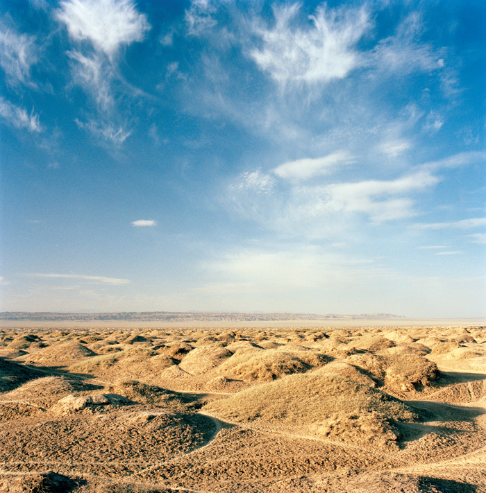 A rocky desert landscape flanks the road into Dunhuang in northwestern Gansu province.
