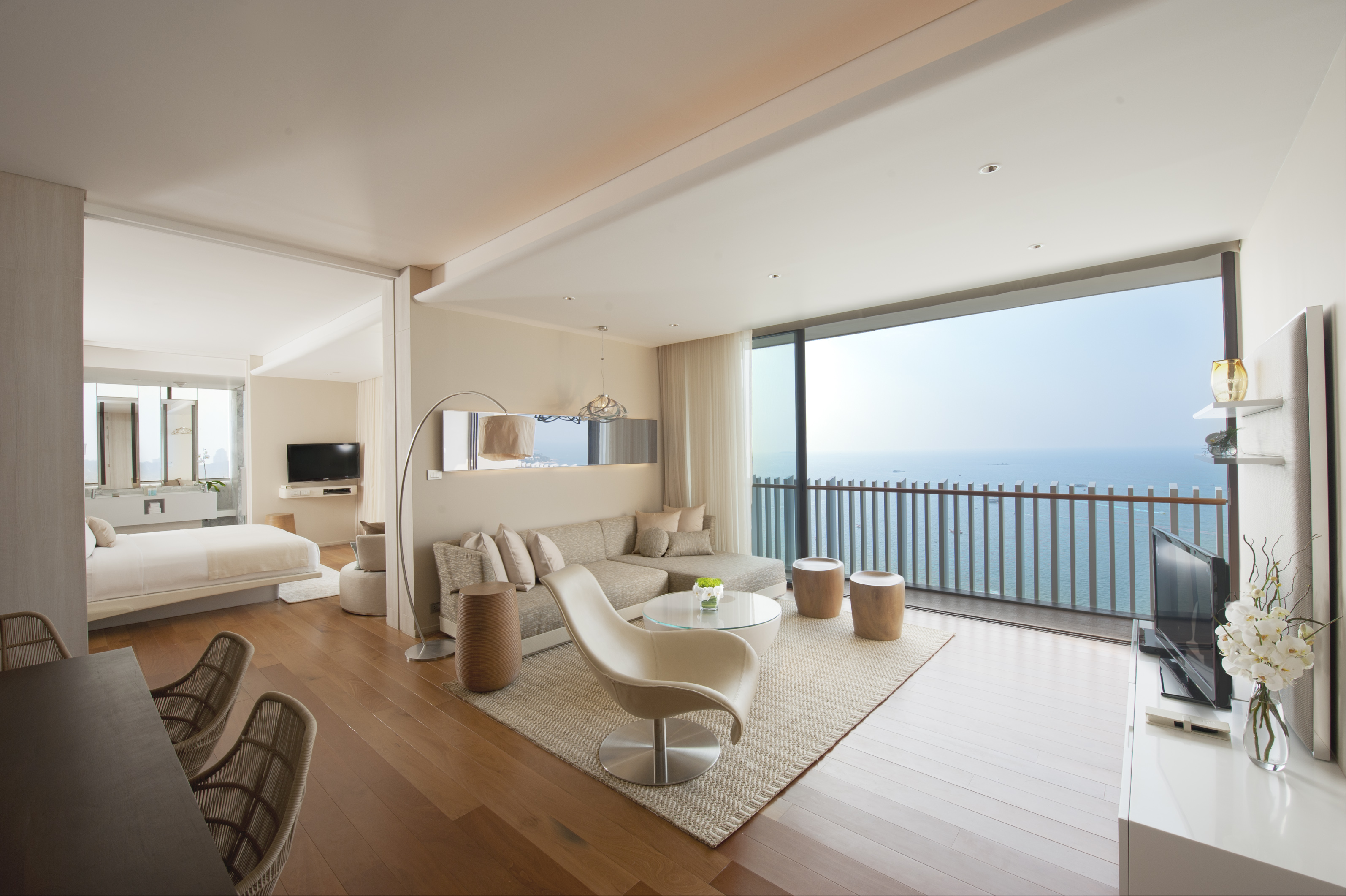 The spacious King Grand Ocean Suite at Hilton Pattaya boasts simplicity and elegance and comes with a view of the ocean.