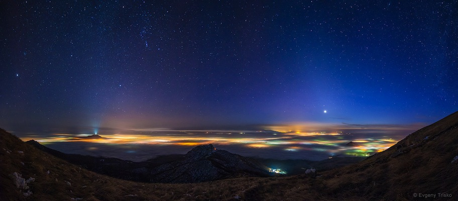 'Above and Underneath' by Evgeny Trisko (www.vk.com/trisko_foto). The night sky above clouds illuminated by towns and villages hidden underneath, photographed in Pyatigorsk, Stavropol region of Russia, February 2015. The 5th winner in the Against the Lights category.