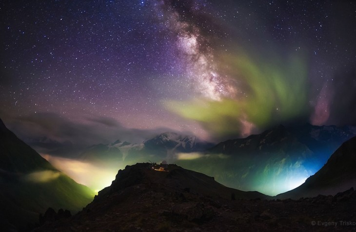 'Above the Light Pollution' by Evgeny Trisko (www.vk.com/trisko_foto). The Milky Way emerges from the clouds over lights in the valley. In the center is the Peak Terskol Observatory near Mt. Elbrus, northern Caucasus Mountains, Russia, photographed in August 2014. The 2nd winner in the Against the Lights category.