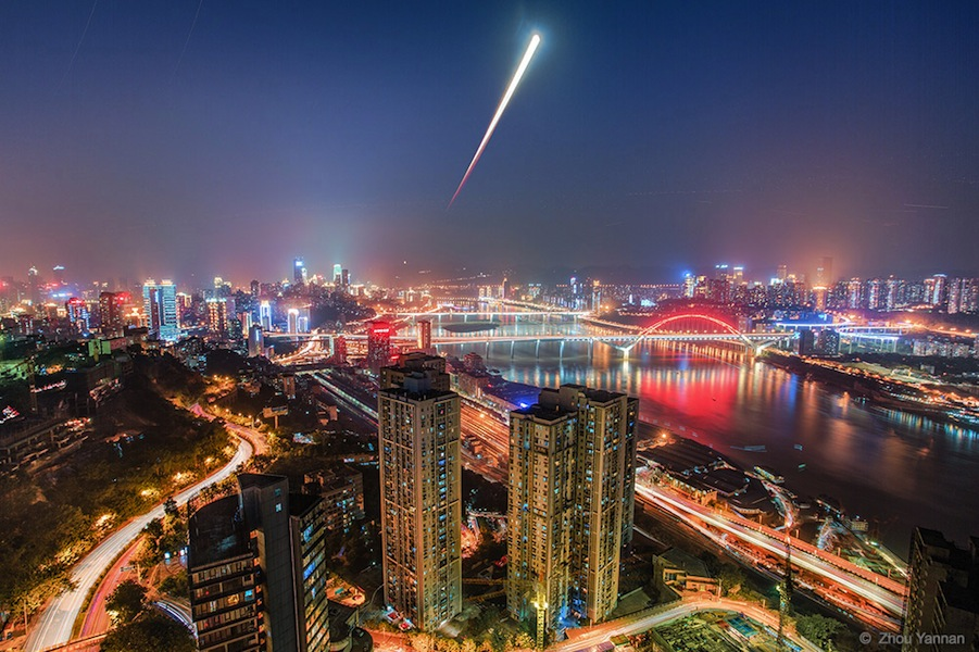 'Blood Moon Rises Over Chongqing' by Zhou Yannan (flickr.com/photos/zhouyannan). As the moon rose and the sun set on October 8, 2014, a lunar eclipse was in progress, as seen from Chongqing, China. In this photo-sequence, the rising eclipsed moon begins as a dark reddened disk and gradually comes out of the shadow while rising above the Yangtze River. The 3rd winner in the Against the Lights category.