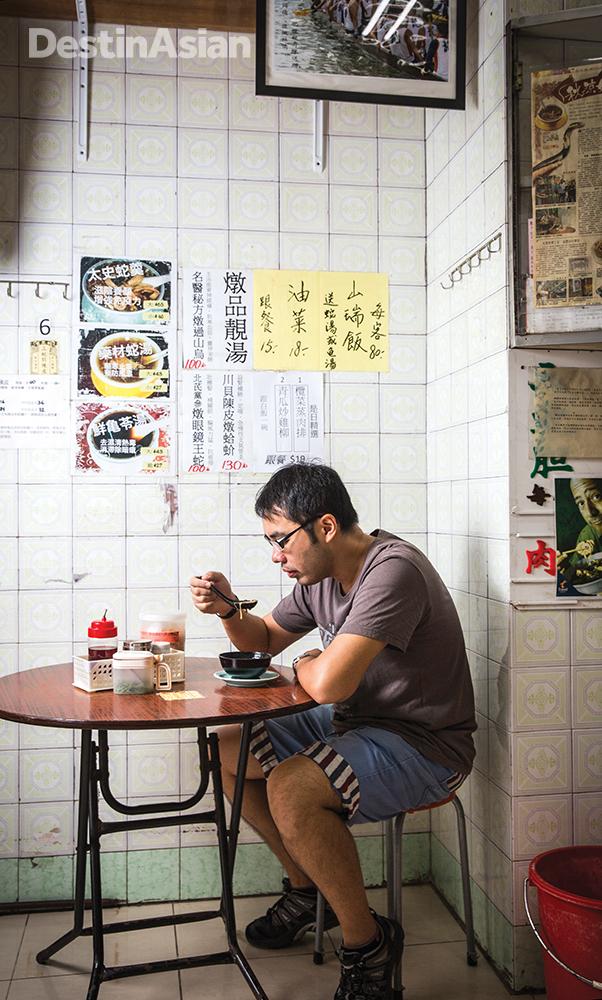 Savoring the snake soup at Shia Wong Hip.
