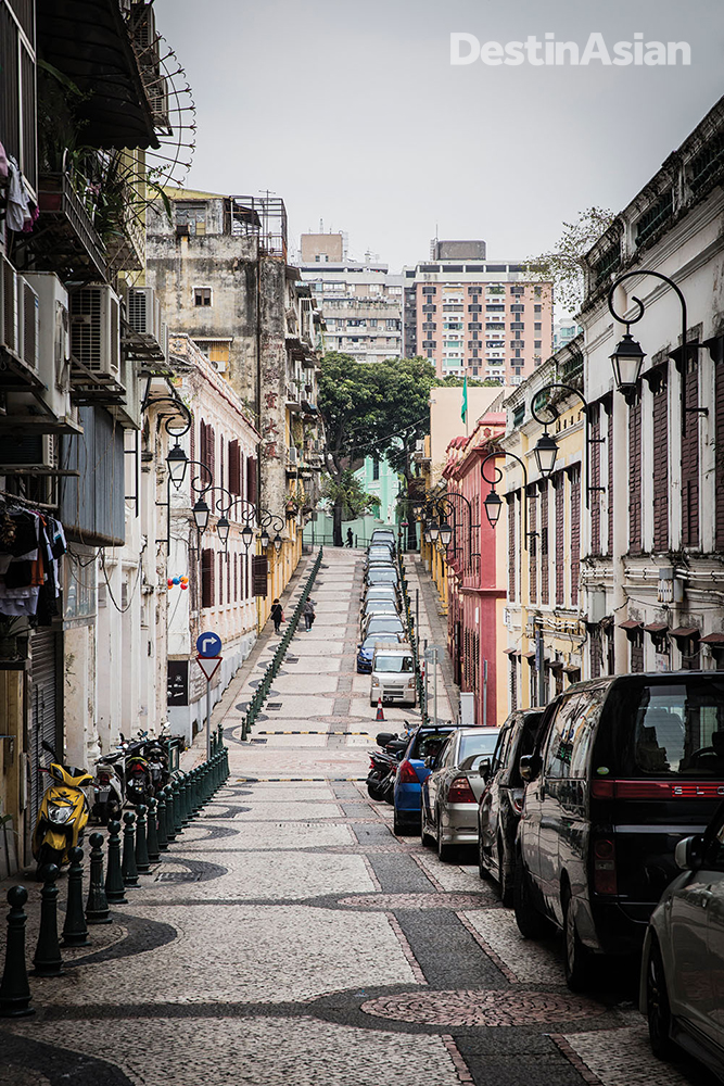 Colonial-era buildings line a tiled street in St. Lazarus Parish.