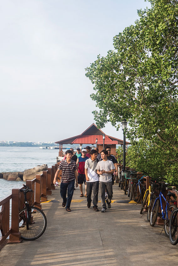 A fresh crop of visitors arriving on Pulau Ubin's main jetty from Singapore.