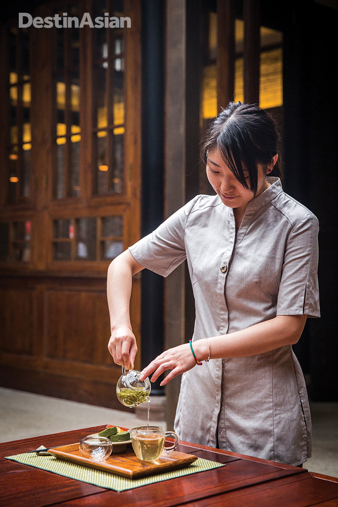The Temple House's apothecary-styled Teahouse serves green tea plucked from the slopes of nearby mountains.