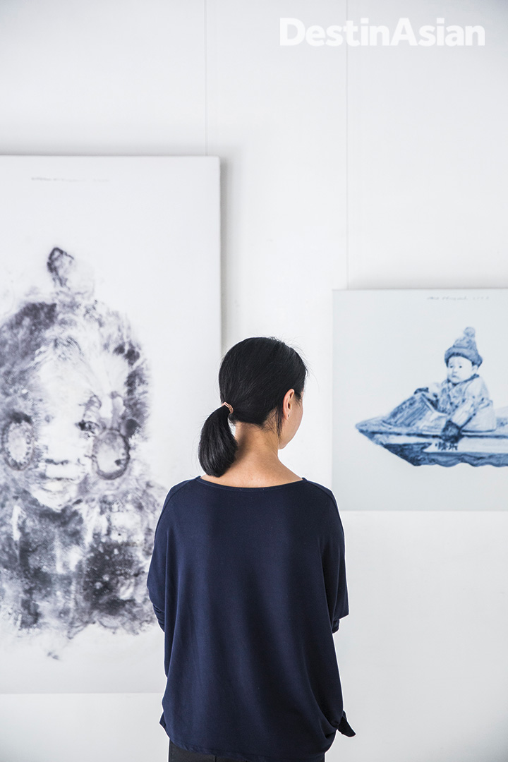 Admiring contemporary Chinese canvases at Connoisseur Art Gallery, a longstanding space on Hollywood Road.