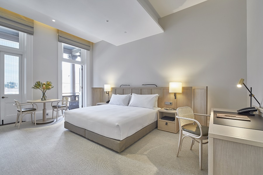 Soft colors and wooden bespoke furniture adorn each room.