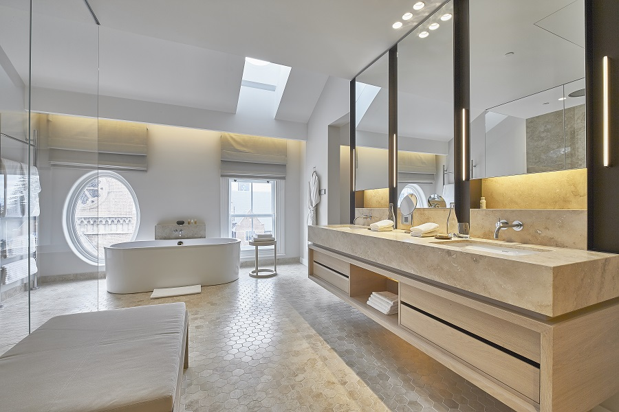 Bathrooms feature Kaldewei bathtubs and vanities, and come with heated floors.