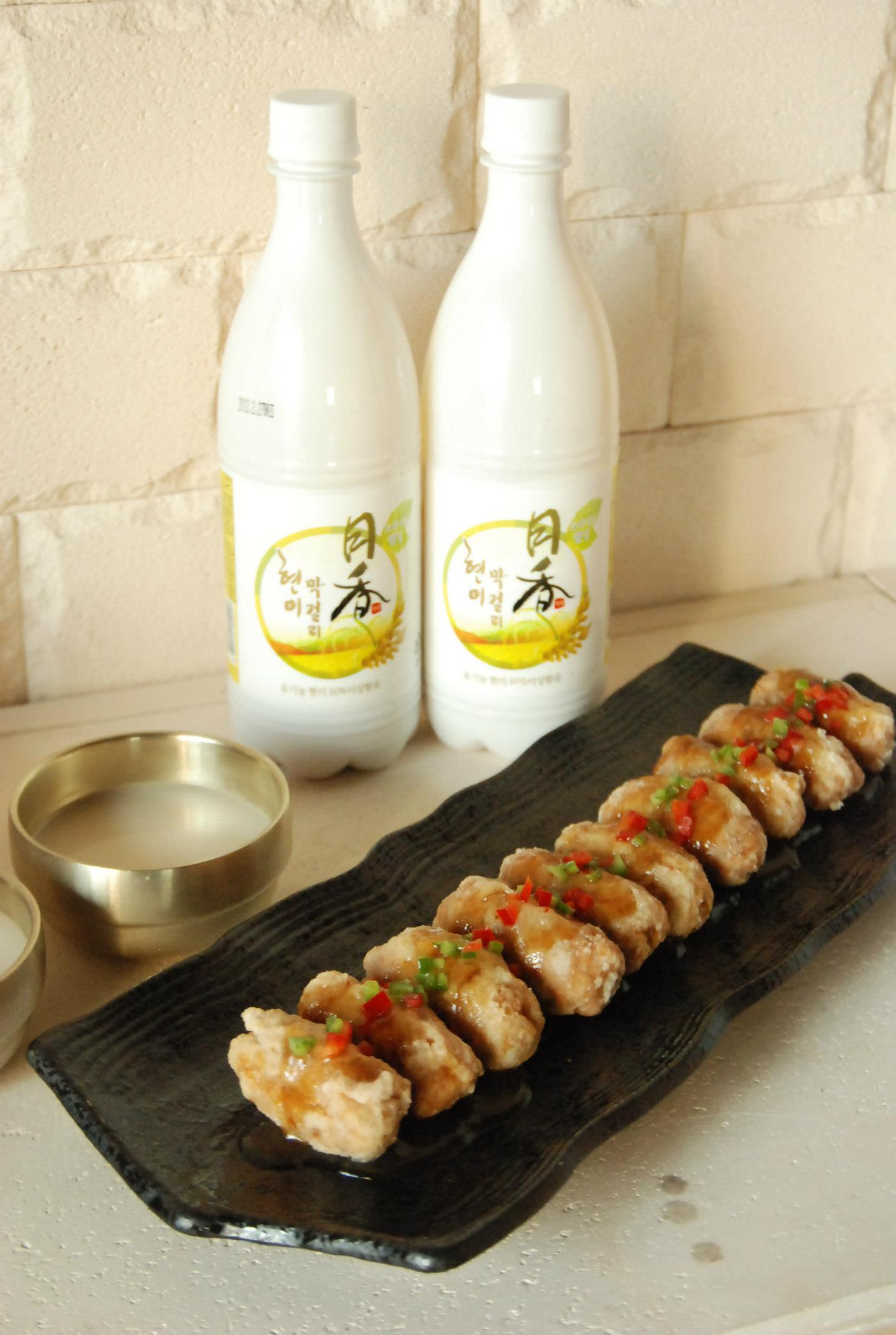 Wolhyang's signature makgeolli rice wine with tang suyuuk or sweet and sour pork.